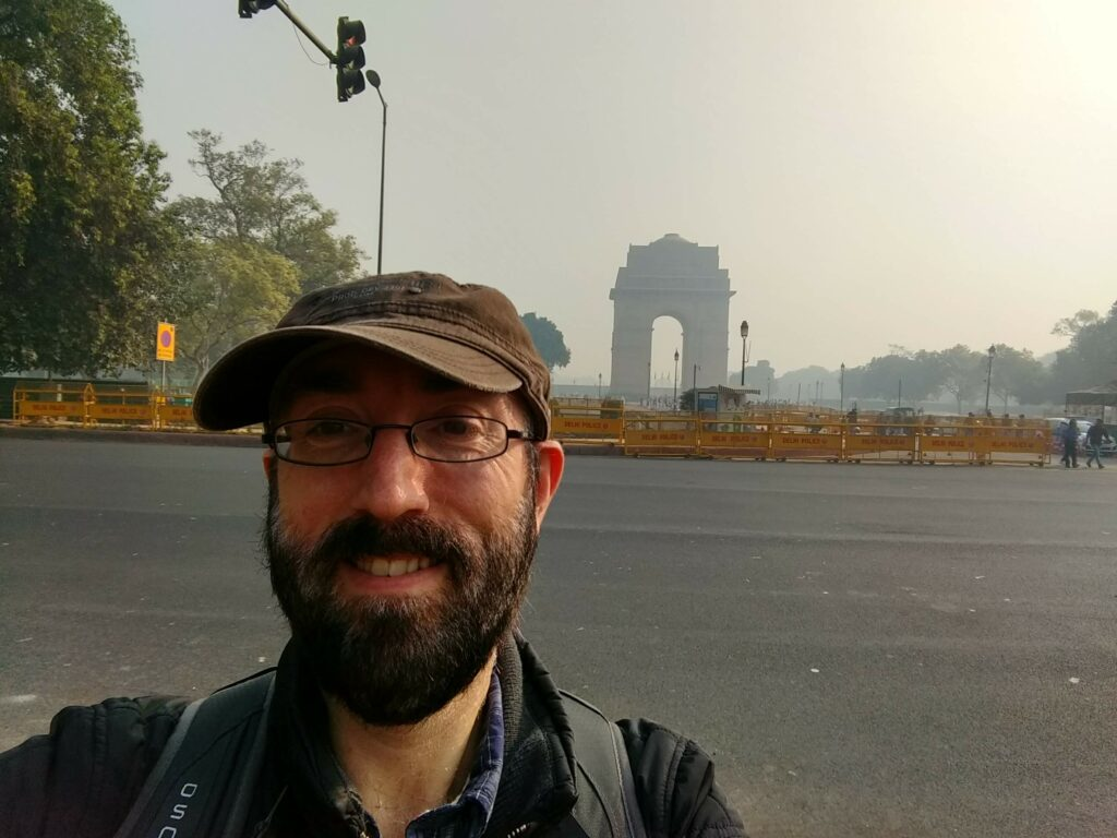 Me in front of the India Gate. There is fog.