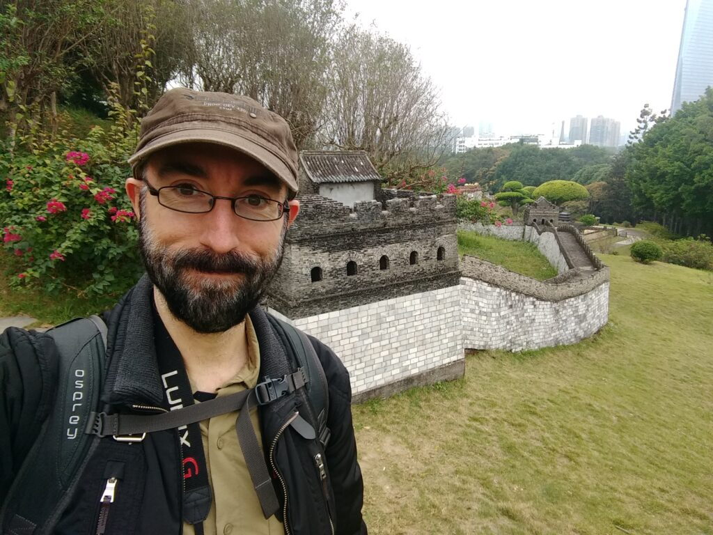 Me with a reproduction of the Great Wall of China in the background.