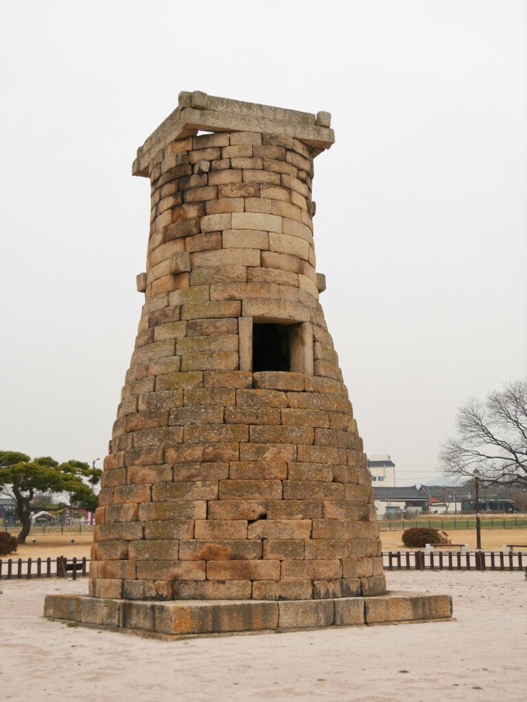Cheomseongdae Observatory made of stone bricks. It has a conical shape, flat at the top.